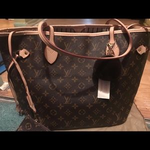 """ FAUX"" Louis Vuitton brand new never used"